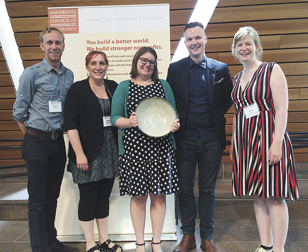 A few of Springboard for the Arts' staff members from Fergus Falls and St. Paul join Michele Anderson as she receives her award. Pictured from left to right are Dan Olson, Naomi Schliesman, Michele Anderson, Carl Atiya Swanson and Molly Chase.
