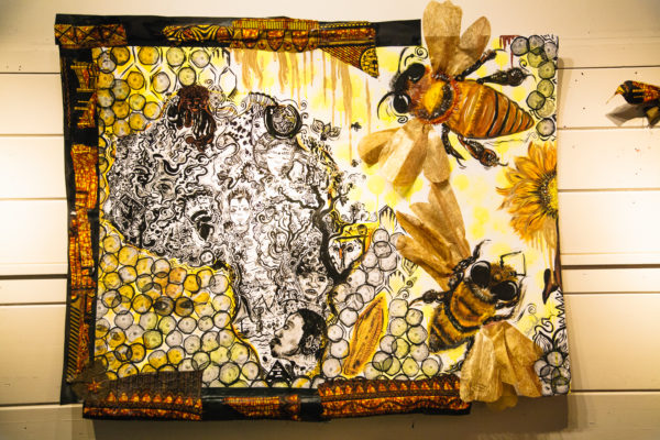 A mural depicting bees and a beehive by Brianna Williams to address racism
