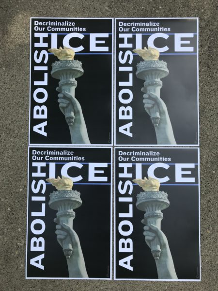 "Posters by artist Leon Wang read ""Abolish ICE"" and depict the Statue of Liberty's land holding a torch"