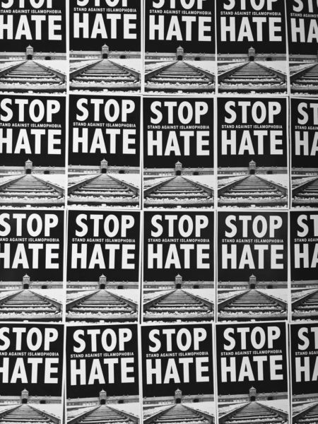 "Posters by Leon Wang read ""Stop Hate"" were made for a rally against ACT of America"