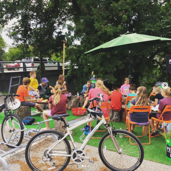 Bicycles and people gathered in a pop-up park