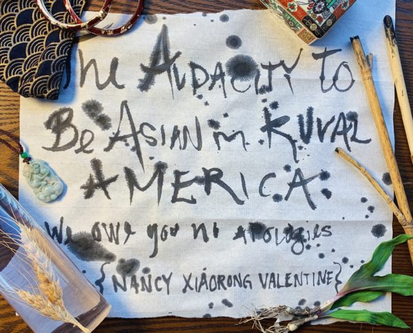 Paper with text: The Audacity of Being Asian in Rural America: We Owe You No Apologies Nancy XiaoRong Valentine